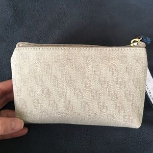 Dooney & Bourke tan canvas cosmetic pouch. New!